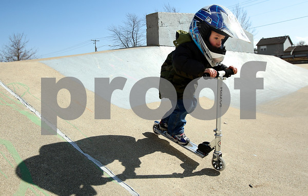 Kyle Bursaw – kbursaw@shawmedia.com<br /> <br /> Donovan Guglielmi, 4, catches speed riding a scooter down a slope in the skatepark area of Katz Park in DeKalb, Ill. while under the supervision of his father Erik Guglielmi on Wednesday, Feb. 29, 2012.