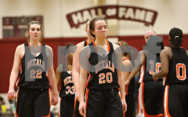 Rob Winner – rwinner@shawmedia.com<br /> <br /> DeKalb's Emily Bemis (22) and Taylor White (20) leave the floor after losing to Bartlett, 48-30, during the Class 4A Elgin Super-Sectional on Monday, February 27, 2012.