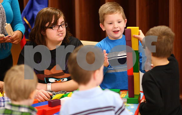 Kyle Bursaw – kbursaw@shawmedia.com<br /> <br /> Kayla Tetzlaff (left), a senior at DeKalb High School, keeps a watchful eye on  four boys, including Sean Kowalski (facing camera), as they play with blocks on Thursday in the Alphabitty Learning Center, a daycare where DeKalb High School students in Tina Holtz's child care occupations classes get to work with children in the community.<br /> <br /> Thursday, Jan. 5, 2012