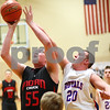 Kyle Bursaw – kbursaw@shawmedia.com<br /> <br /> Hinckley-Big Rock's Zach Michels contests a shot by Indian Creek's Garrison Govig in the first quarter of the Little Ten Conference Tournament semifinal game at Somonauk High School on Thursday, Feb. 2, 2012.