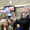 "Kyle Bursaw – kbursaw@shawmedia.com<br /> <br /> Superintendent Jim Briscoe addresses the crowd from atop the treadmills at the grand opening of the new satellite site dubbed ""DeKalb Barb City YMCA at Huntley Middle School"" on Thursday, Jan. 19, 2012."