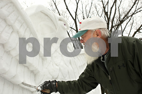 Rob Winner – rwinner@shawmedia.com<br /> <br /> On Wednesday afternoon outside his Sycamore home Lynden Bute uses a knife while creating his newest snow sculpture which features an American bald eagle.<br /> <br /> Wednesday, Jan. 25, 2012<br /> Sycamore, Ill.