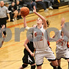Rob Winner – rwinner@shawmedia.com<br /> <br /> DeKalb's Emily Bemis is able to get a shot off for two while picking up the foul that she made for a three-point play during the third quarter in DeKalb on Tuesday, Jan. 31, 2012. DeKalb defeated Kaneland, 46-31.