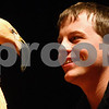 Kyle Bursaw – kbursaw@shawmedia.com<br /> <br /> Saul Bauer, one of Jack Hanna's crew members, interacts with a Chilean flamingo onstage during the 'Into the Wild Live' show at the Egyptian Theatre in DeKalb, Ill. on Sunday, March 11, 2012.