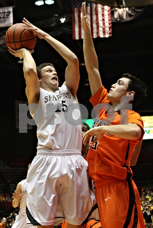 Rob Winner – rwinner@shawmedia.com<br /> <br /> Sycamore's Devin Mottet (15) takes a shot as DeKalb's Kyle Berg (25) defends during the second quarter.