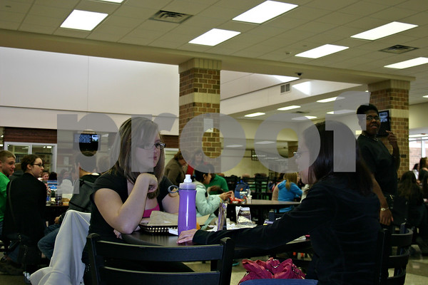 Kayla Hays (left) talks with friend Veronica Perez, both seniors, during lunch Monday at DeKalb High School. School was back in session Monday following the holiday break for students and staff of DeKalb School District 428.<br /> <br /> Caitlin Mullen - cmullen@shawmedia.com