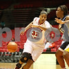 Rob Winner – rwinner@shawmedia.com<br /> <br /> Toledo's Andola Dortch (left) nearly makes a steal as Northern Illinois' Natecia Augusta (32) begins a drive to the basket while being defended by Toledo's Yolanda Richardson (33) during the second half in DeKalb on Saturday afternoon. Toledo defeated NIU, 49-47.