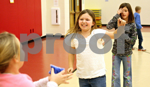 Rob Winner – rwinner@shawmedia.com<br /> <br /> (From left to right) Katie Chitwood, 7, Avery DeRuyter, 8, and Emily Raetzke, 10, play a game involving a beanbag during an after-school CATCH Program physical activity at Southeast Elementary School in Sycamore on Tuesday, Jan. 10, 2012. CATCH stands for a Coordinated Approach To Child Health and is a coordinated school health program designed to promote physical activity, healthy food choices and the prevention of tobacco use in children.