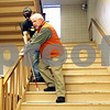Rob Winner – rwinner@shawmedia.com<br /> <br /> Northern Illinois University instructor Dr. William Penrod (front), with the help of Nathan LaForte, demonstrates how to safely prevent a visually impaired person from falling down stairs during an orientation and mobility class at NIU in DeKalb on Friday evening.<br /> <br /> DeKalb. Ill.<br /> Friday, Jan. 27, 2012