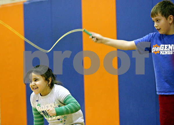 Rob Winner – rwinner@shawmedia.com<br /> <br /> Marbelyn Galarza, 7, and Jakob Floyel, 7, participate in the American Heart Association's Jump Rope for Heart fundraiser for those with heart problems on Wednesday afternoon at Kingston Elementary School.