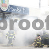 Kyle Bursaw – kbursaw@shawmedia.com<br /> <br /> Cortland firefighters work to douse a fire in a Ford Ranger parked at the Kelley's Market in Cortland, Ill. on Friday, March 23, 2012.