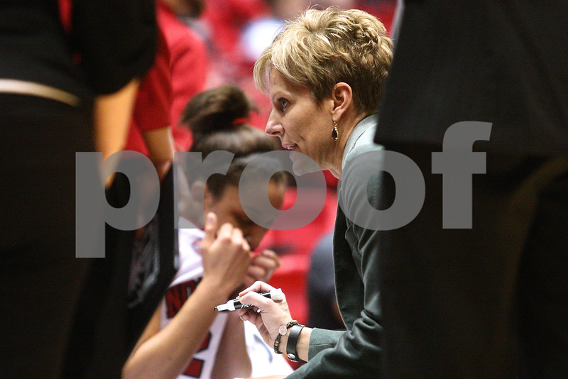 Kyle Bursaw – kbursaw@shawmedia.com<br /> <br /> Northern Illinois head coach Kathi Bennett draws up a play for her team during a timeout in the second half of the Huskies' 66-64 loss to Western Michigan on Tuesday, Feb. 28, 2012.