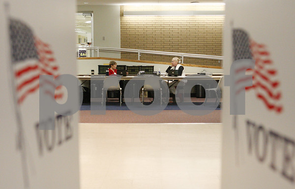 Rob Winner – rwinner@shawmedia.com<br /> <br /> Election judges Audrey Willett (left) and Nancy Higdon talk while waiting for voters within the Holmes Student Center on the Northern Illinois University campus in DeKalb on Monday afternoon. As of 2 p.m. seven people had cast their vote.
