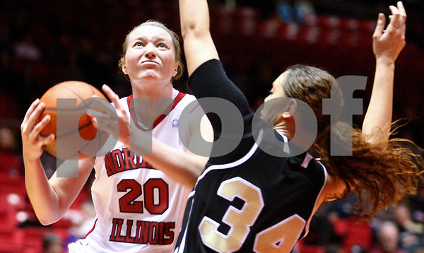 Kyle Bursaw – kbursaw@shawmedia.com<br /> <br /> Northern Illinois forward Jenna Thorp goes up for a shot against the defense of Western Michigan forward Robin Giden in the first half of the game at the Convocation Center on Tuesday, Feb. 28, 2012.