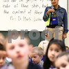"Kyle Bursaw – kbursaw@shawmedia.com<br /> <br /> Brooks Elementary Principal Shahran Spears and other students listen as a teacher spotlights the accomplishments of a student during the school's daily 'rise and shine' assembly on Friday, Jan. 13, 2012. Behind Spears the white board features a quote from Rev. Dr. Martin Luther King Jr. that reads: ""I look to a day when people will not be judged by the color of their skin but by the content of their character."""