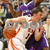 Rob Winner – rwinner@shawmedia.com<br /> <br /> DeKalb's Brian Sisler drives the ball past Rochelle defender Chris Williams during the fourth quarter in DeKalb on Friday, Feb. 17, 2012. DeKalb defeated Rochelle, 69-67.