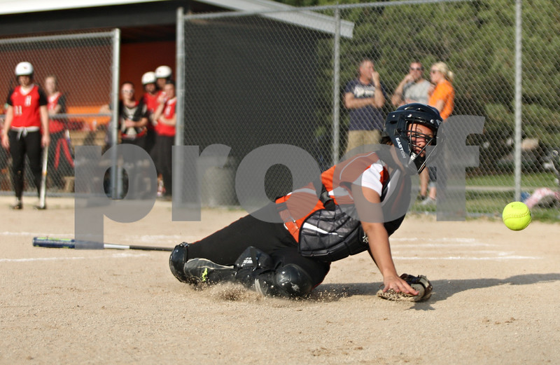 Rob Winner – rwinner@shawmedia.com<br /> <br /> DeKalb catcher Alysha Guy is unable to catch a bunt attempt which landed untouched in foul territory during the top of the fourth inning in DeKalb on Wednesday.