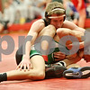 Rob Winner – rwinner@shawmedia.com<br /> <br /> DeKalb's Brad Green (top) competes with Geneseo's Tristan Thies during the Northern Illinois Big 12 Conference tournament 120-pound quarterfinals in Ottawa on Saturday.