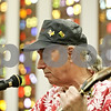 Rob Winner – rwinner@shawmedia.com<br /> <br /> Dave Kolars plays the guitar and sings for the guests of the Winter Farmers' Market at the Unitarian Universalist Fellowship of DeKalb on Saturday morning.