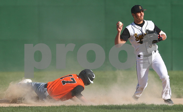 Kyle Bursaw – kbursaw@shawmedia.com<br /> <br /> Sycamore's Mitchell Jordan throws to first base after getting out DeKalb's Tyler Gosnell at second base at Sycamore Park on Monday, April 9, 2012. Sycamore defeated DeKalb 15-5.