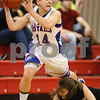 Kyle Bursaw – kbursaw@shawmedia.com<br /> <br /> Hinckley-Big Rock's Kaitlin Phillips passes while tripping over Indian Creek's Alyssa Arends after Phillips came up with a with a loose ball in the  third quarter of their Little Ten Conference Tournament game in Earlville on Monday, Jan. 16, 2012. Hinckley-Big Rock defeated Indian Creek 58-23.
