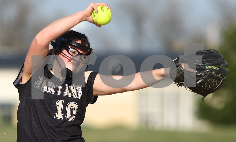 Kyle Bursaw – kbursaw@shawmedia.com<br /> <br /> Sycamore's Abby Foulk winds up a pitch against Ottawa in the first inning of the game in Sycamore, Ill. on Monday, March 19, 2012. Ottawa defeated Sycamore 2-1.