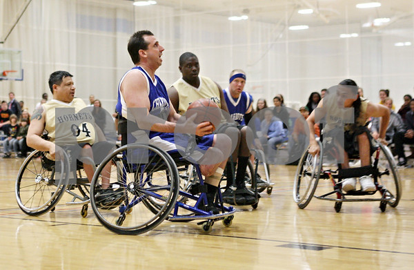 Rob Winner – rwinner@shawmedia.com<br /> <br /> Doug Beale of the Rockford Chariots looks to shoot during a wheelchair basketball game hosted by the Northern Illinois Presidential Commission on Persons with Disabilities and the Center for Access-Ability Resources at the NIU Student Recreation Center in DeKalb Thursday evening.