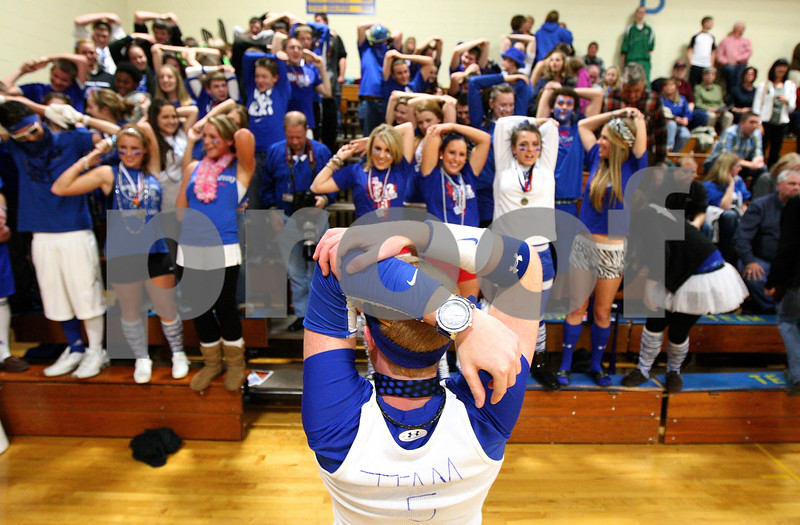 Kyle Bursaw – kbursaw@shawmedia.com<br /> <br /> Hinckley-Big Rock senior Cory Bradburn leads his classmates in a pre-game stretch routine before the Royals played Somonauk in the Little Ten Conference tournament championship game on Friday, Feb. 3, 2012.