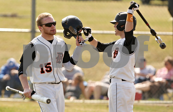 Rob Winner – rwinner@shawmedia.com<br /> <br /> After scoring a run in the fourth inning DeKalb's Jeremy Karasewski (15) is greeted by teammate Kevin Sullivan in DeKalb on Saturday, March 17, 2012.