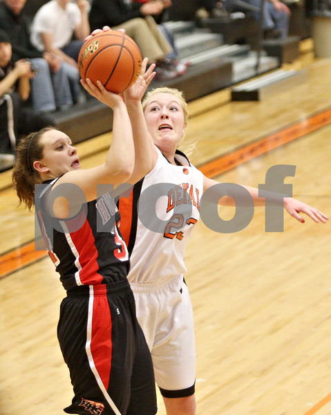 Rob Winner – rwinner@shawmedia.com<br /> <br /> Huntley's Haley Sabie (left) has her shot blocked by DeKalb's Maddy Johnson (23) in the second quarter during the Class 4A DeKalb Regional final on Thursday, Feb. 16, 2012. DeKalb defeated Huntley, 55-40.