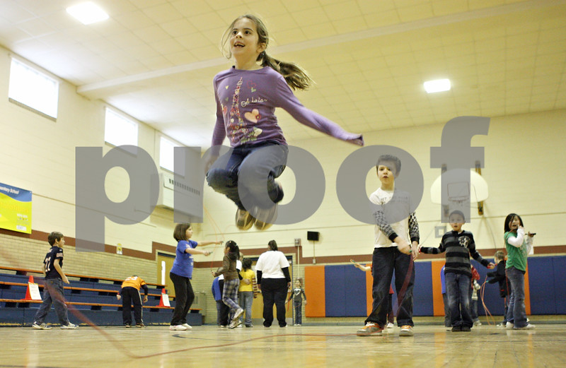 Rob Winner – rwinner@shawmedia.com<br /> <br /> Emma Lippold, 7, jumps while participating in the American Heart Association's Jump Rope for Heart fundraiser for those with heart problems on Wednesday afternoon at Kingston Elementary School.