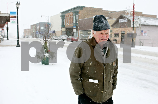 Rob Winner – rwinner@shawmedia.com<br /> <br /> Hinckley resident Pat VanBarriger makes his way along West Lincoln Avenue in downtown Hinckley as snow covers the streets and sidewalks on Thursday, Jan. 12, 2012.