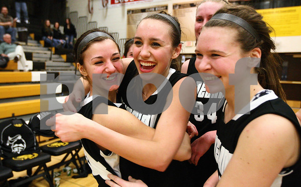 Kyle Bursaw – kbursaw@shawmedia.com<br /> <br /> (From Left) Alli Liss, Emma Bradford and Allyson O'Herron celebrate Kaneland's 40-31 victory over Hampshire at Sycamore High School on Monday, Feb. 20, 2012.