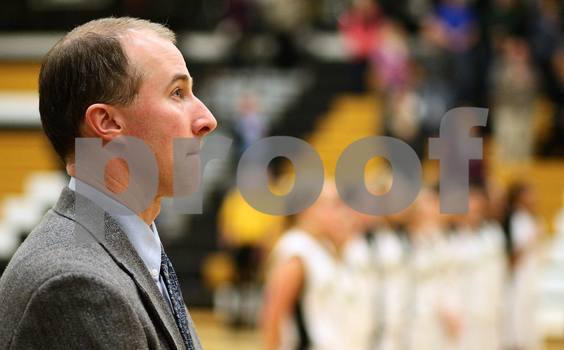 Kyle Bursaw – kbursaw@shawmedia.com<br /> <br /> Sycamore coach Brett Goff looks to the flag during the national anthem before the Spartans' game against Yorkville on Tuesday, Jan. 24, 2012.