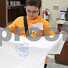 Rob Winner – rwinner@shawmedia.com<br /> <br /> Cortland Elementary School student Trevor Yaeger, 10, removes a t-shirt from a dryer that he made during a screen printing session at the Students Involved with Technology Conference on Saturday afternoon at DeKalb High School. SIT is a conference presented by school districts that provide a forum where kids in grades three to twelve can demonstrate technology tools they have learned in school or that they are interested in.<br /> <br /> Yaeger (sp)<br /> DeKalb, Ill.<br /> Saturday, Feb. 18, 2012