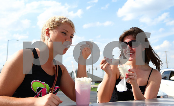 Kyle Bursaw – kbursaw@shawmedia.com<br /> <br /> Gloria Schmitz (left) and NIU student Jessica Hegland, both 19, enjoy some icy treats from Ollie's Frozen Custard in Sycamore, Ill. on Wednesday, March 21, 2012.
