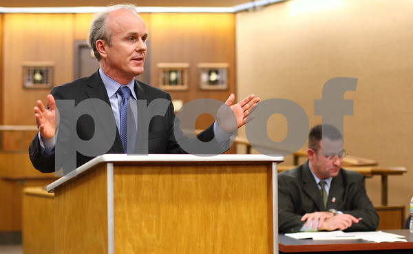 Kyle Bursaw – kbursaw@shawmedia.com<br /> <br /> Incumbent DeKalb County State's Attorney Clay Campbell answers a question as his challenger Sean Smith (background) waits for his turn during their debate in Swen Parson Hall at Northern Illinois University on Tuesday, March 6, 2012.