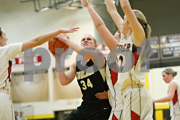 Rob Winner – rwinner@shawmedia.com<br /> <br /> Kaneland's Kelly Evers (34) is fouled by Belvidere North's Kirsten Larson (left) during the first quarter in a Class 3A Sycamore championship on Thursday, Feb. 23, 2012.