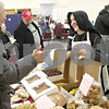 Rob Winner – rwinner@shawmedia.com<br /> <br /> Sister Marie Valerie of Fraternite Notre Dame speaks with a customer while selling pastries at Saturday's Winter Farmers' Market at the Unitarian Universalist Fellowship of DeKalb.