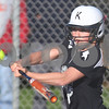 Kyle Bursaw – kbursaw@shawmedia.com<br /> <br /> Kaneland batter Lexi Roach connects with a Katie Kowalski pitch during their game at Huntley Middle School on Thursday, April 5, 2012.