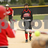 Rob Winner – rwinner@shawmedia.com<br /> <br /> LaMoille batter Ashley Schrader (left) strikes out on a pitch delivered from Indian Creek's Khloe Gordon during the first inning Friday in Shabbona. Indian Creek defeated LaMoille, 21-7, in five innings.