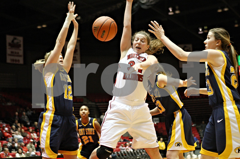 Rob Winner – rwinner@shawmedia.com<br /> <br /> Northern Illinois forward Claire Jakubicek (34) is fouled from behind by Kent State center Leslie Schaefer during the first half in DeKalb on Saturday.