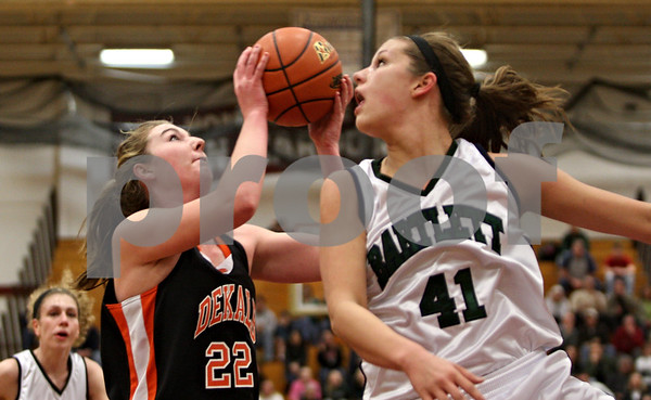 Rob Winner – rwinner@shawmedia.com<br /> <br /> After controlling her own rebound, Emily Bemis puts up a shot ahead of Bartlett's Lisa Palmer in the first quarter during the Class 4A Elgin Super-Sectional on Monday, February 27, 2012.