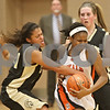 Rob Winner – rwinner@shawmedia.com<br /> <br /> Sycamore's Olyvia Rand (left) fouls DeKalb's Janay Wright during the fourth quarter in DeKalb on Thursday, Feb. 9, 2012.