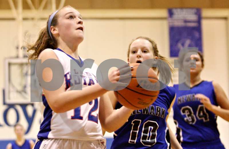 Rob Winner – rwinner@shawmedia.com<br /> <br /> After a steal, Hinckley-Big Rock's Katie Hollis goes to the basket before being fouled by Newark's Abbey Akre (10) during the second quarter in Hinckley.