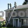 Caitlin Mullen – cmullen@shawmedia.com<br /> <br /> After extinguishing a fire in the chimney, DeKalb firefighters check for damage Monday afternoon to the roof of a home in the 8400 block of West Fairview Drive. No one was injured.<br /> <br /> Monday, April 9, 2012