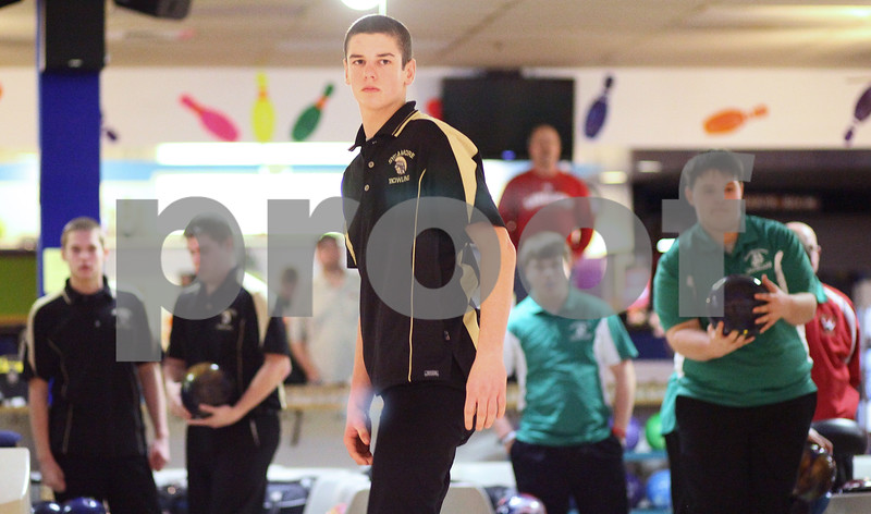 Kyle Bursaw – kbursaw@shawmedia.com<br /> <br /> Sycamore's Tony O'Donnell watches his ball roll down a lane at Four Seasons in Sycamore during the Northern Illinois Big 12 Conference Boys Bowling Tournament on Monday, Jan. 9, 2012.