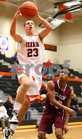 Kyle Bursaw – kbursaw@shawmedia.com<br /> <br /> DeKalb forward Dan Matya rises over the defense of Elgin's Cortez Scott to put in a layup in the third quarter of the game. Elgin defeated the Barbs 50-48 at DeKalb High School on Tuesday, Feb. 7, 2012.