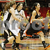 Rob Winner – rwinner@shawmedia.com<br /> <br /> DeKalb's Rachel Torres looks to pass during the second half while facing Sycamore at the Convocation Center in DeKalb on Friday, Jan. 27, 2012.