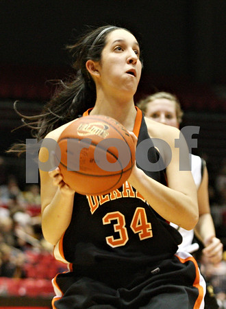 Rob Winner – rwinner@shawmedia.com<br /> <br /> DeKalb's Rachel Torres looks to shoot during the second half while facing Sycamore at the Convocation Center in DeKalb on Friday, Jan. 27, 2012.